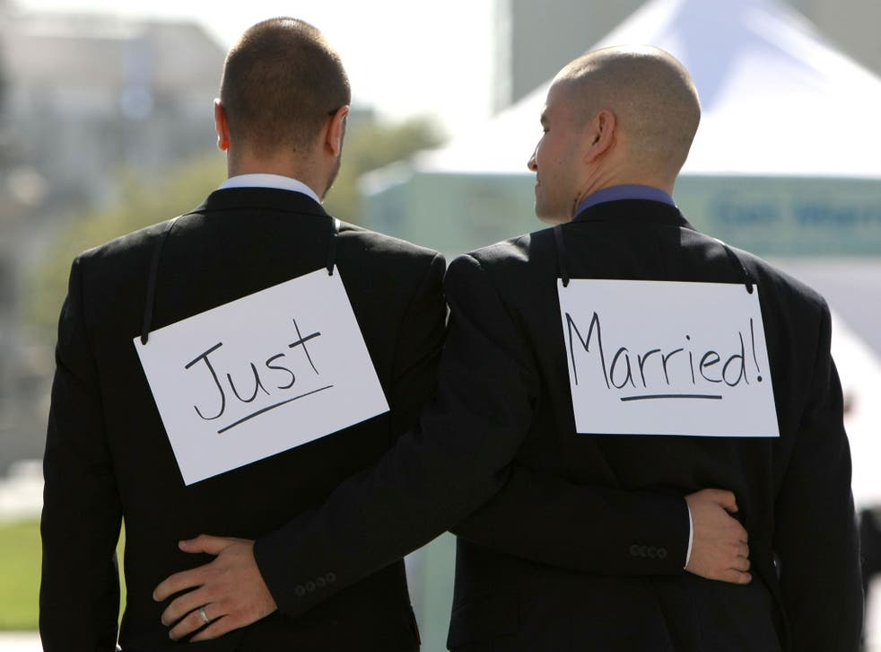 Same-sex couple Ariel Owens (R) and his spouse Joseph Barham walk arm in arm after they were married at San Francisco City Hall June 17, 2008 in San Francisco, California.
