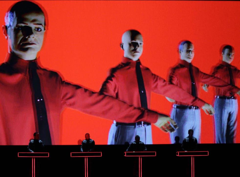 German electronic-music pioneers Kraftwerk perform in the Turbine Hall of Tate Modern against a giant backdrop