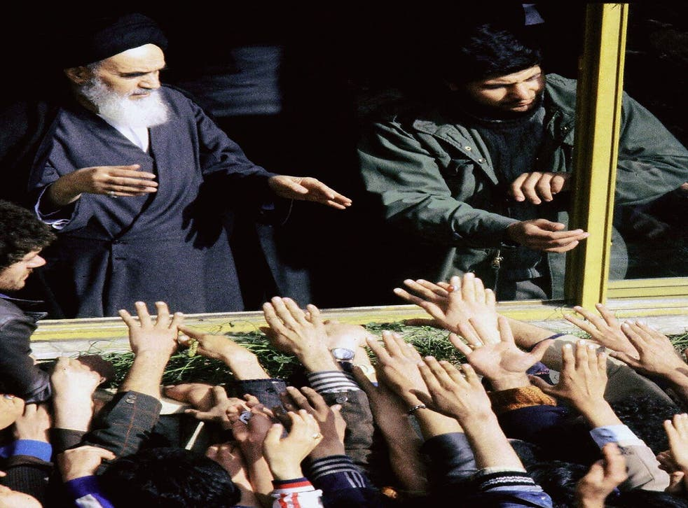 The Islamic Revolution's founder Ayatollah Ruhollah Khomeini (L) greeted in 1979 in Tehran by his supporters during his return to Iran after 15 years in exile in Iraq and France