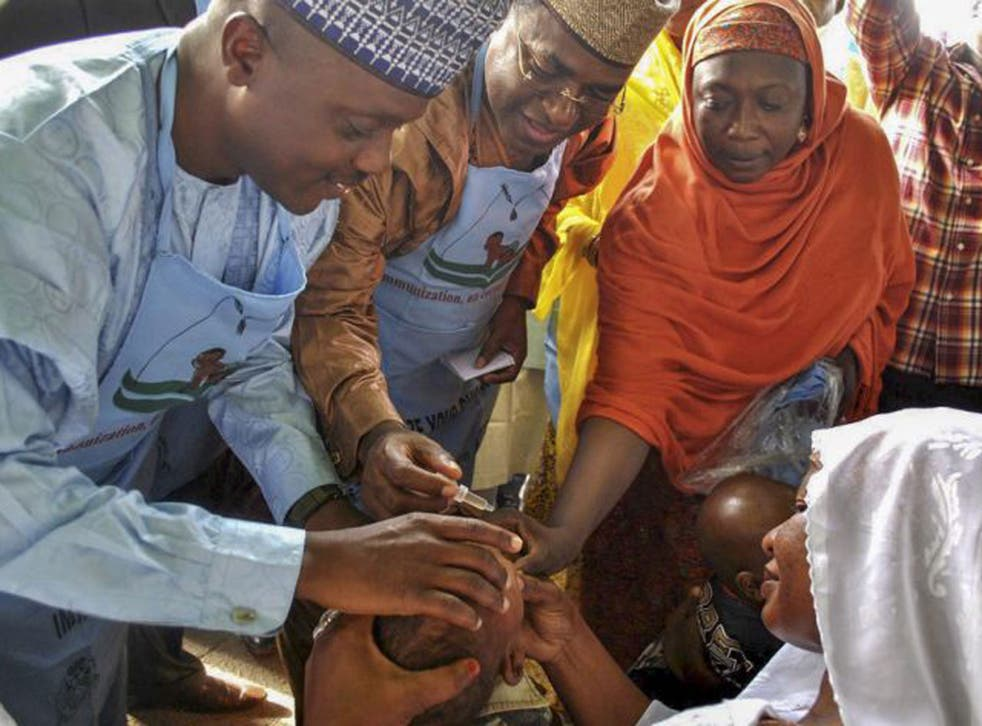A Nigerian child is given the polio vaccine. According to police reports clinics administering the vaccine have been targetted by gunmen thought to be aligned with the Boko Haram sect
