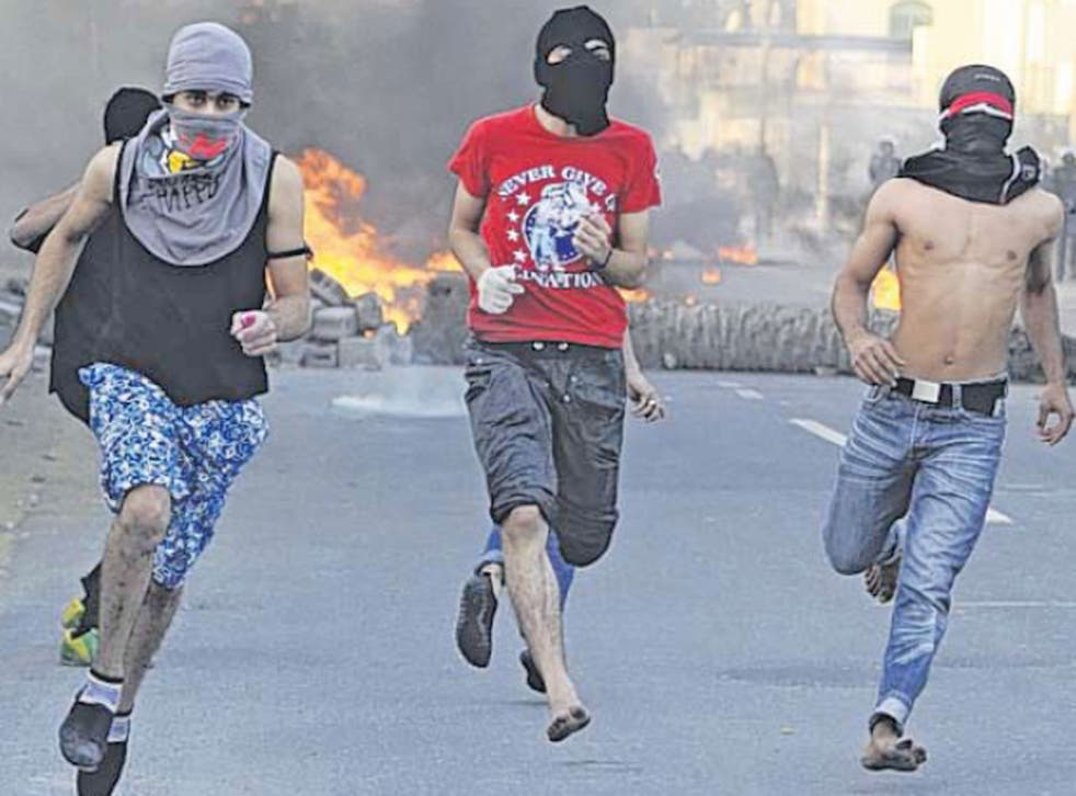 Youths flee after hurling petrol-bombs at police near Manama