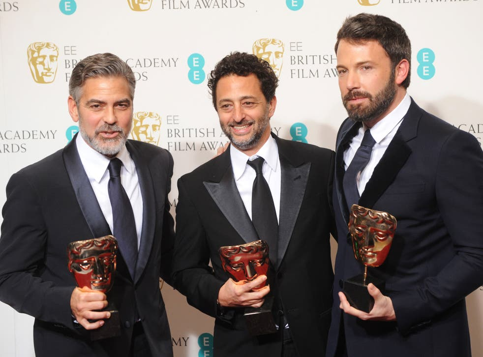 George Clooney, Grant Heslov and Ben Affleck, winners of the Best Film award for 'Argo', pose in the press room at the EE British Academy Film Awards at The Royal Opera House on February 10, 2013 in London, England.