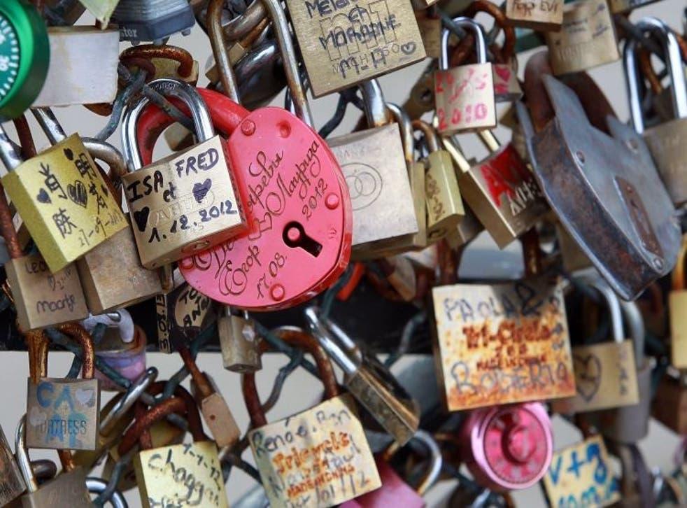 Padlocks adorn the Pont des Arts in Paris
