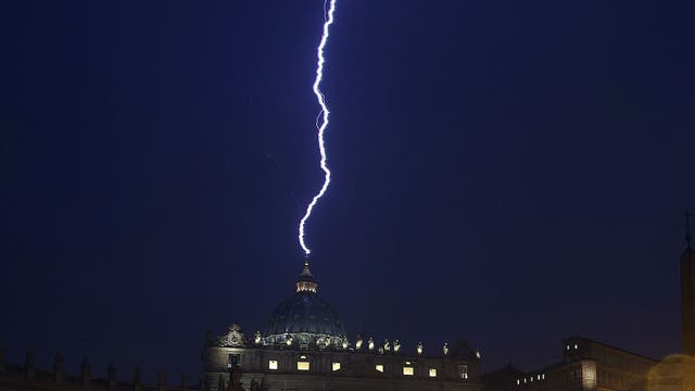 A flash of lightning is seen over St Peter's Basilica during a rainstorm last night