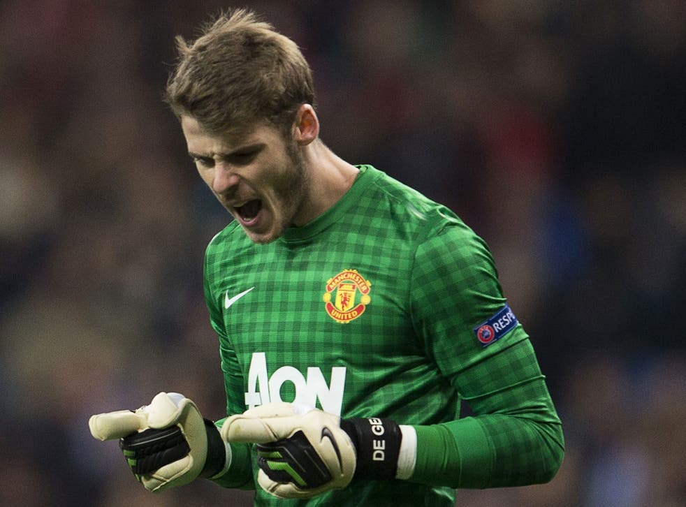 Manchester United goalkeeper David  de Gea celebrates at the end of Wednesday's match at the Bernabeu