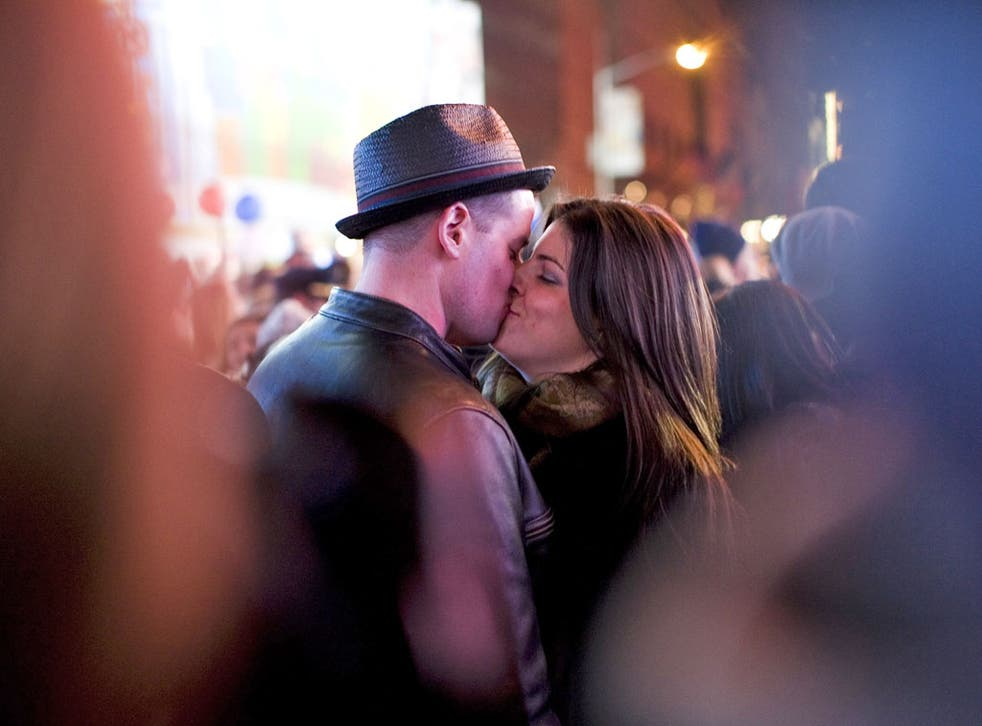 A couple kisses in Times Square, New York