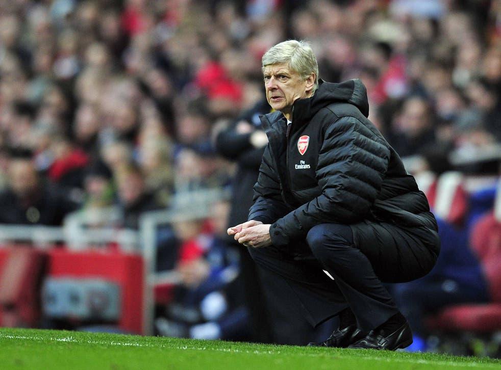 Arsenal manager Arsene Wenger looks on