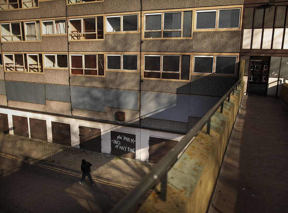 A man walks in late afternoon sunshine on the Heygate housing estate near Elephant and Castle on February 11, 2010 in London, England.