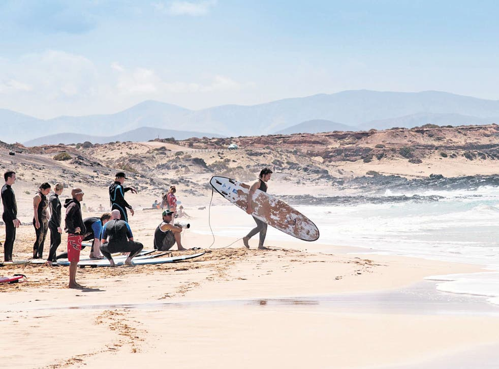 All aboard: surfers prepare to ride the waves at Playa Cotillo