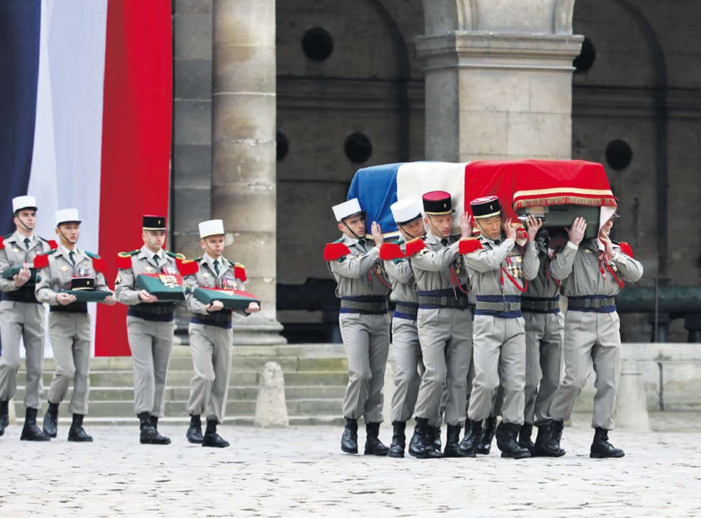 Endless war: French troops carry the coffin on Friday of a soldier killed in Mali