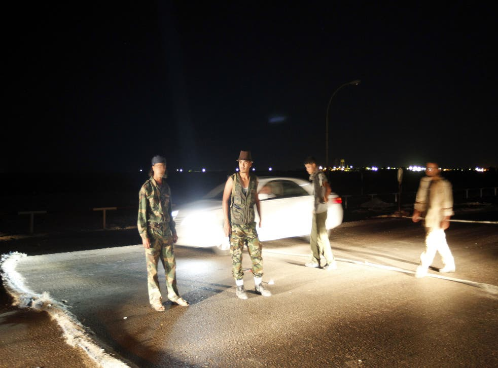 Armed Libyans claiming to be federalist supporters set up a checkpoint outside Sidra oil terminal in 2012