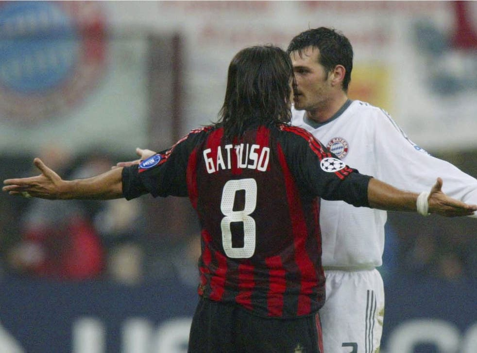 FC Sion's new manager Gennaro Gattuso squres up with Bayern Munich's Willy Sagnol in 2002