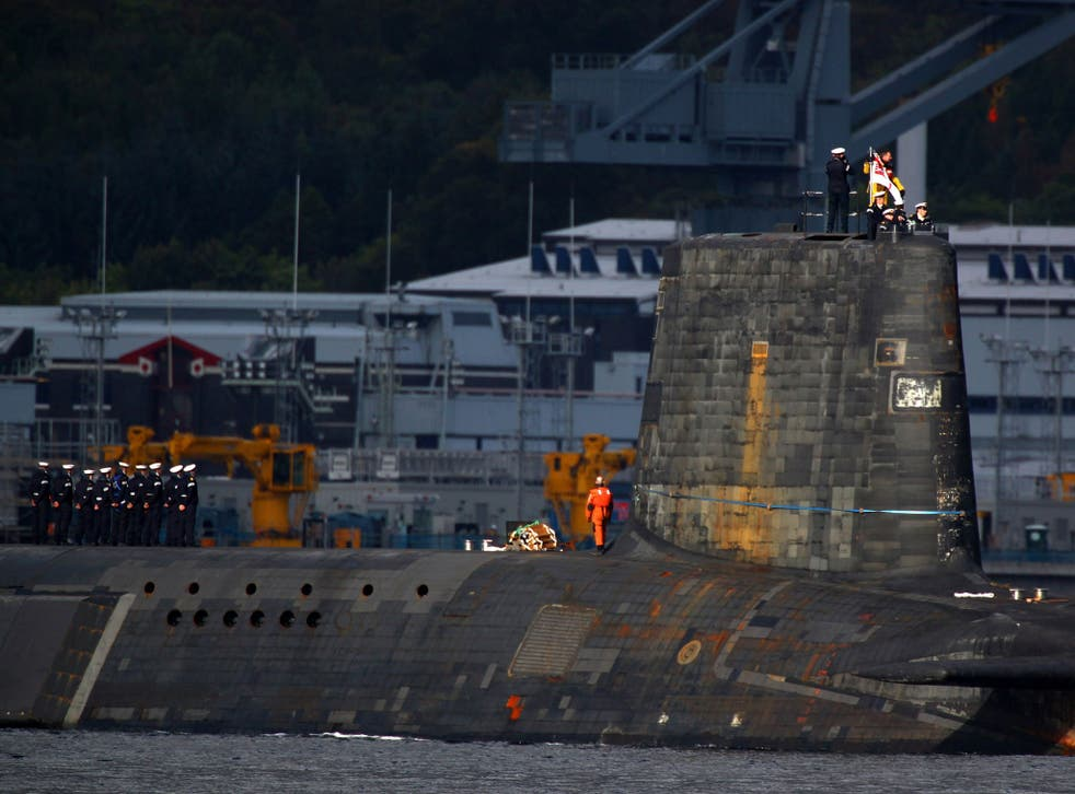 A trident submarine makes it's way out from Faslane Naval base on September 23, 2009 in Faslane, Scotland.