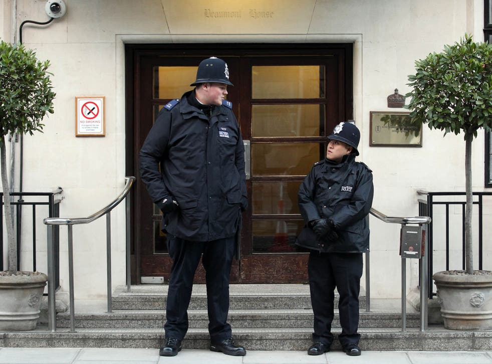 Pc Anthony Wallyn (left), who stands at 7ft 2ins tall, towering over his colleague, Pc Tony Thich, who is 5ft 6ins and the smallest officer in the Met's Westminster Borough Support Unit