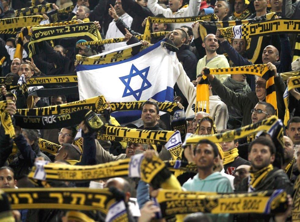 Beitar Jerusalem's supporters chant slogans during an Israeli championship football match