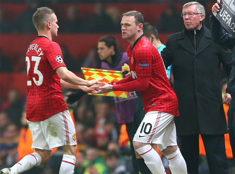 Sir Alex Ferguson looks on as Wayne Rooney comes on as a sub