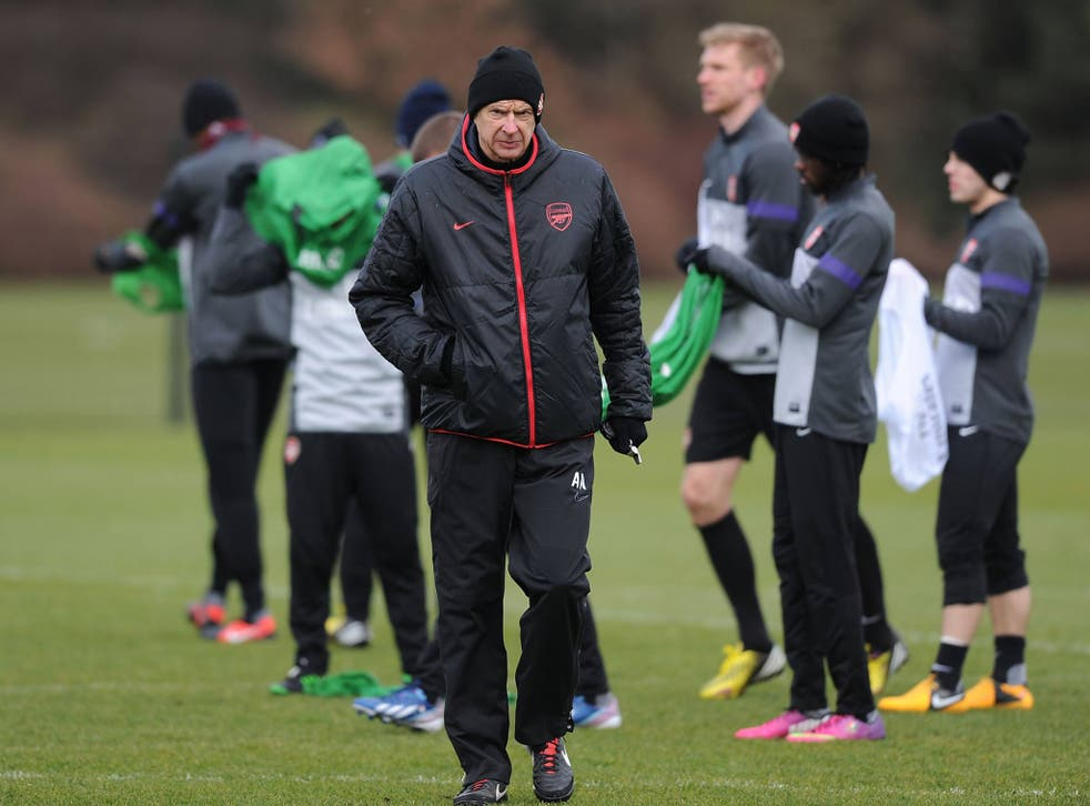 Arsene Wenger trains with his Arsenal players