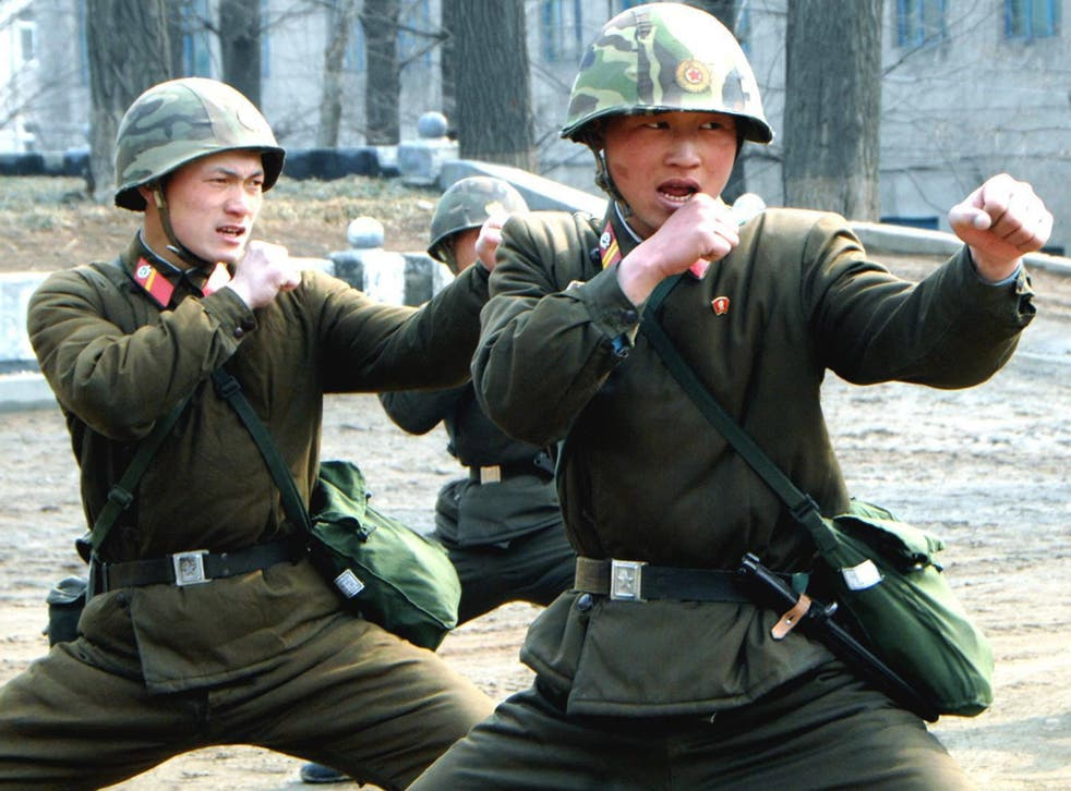 North Korean soldiers carry out combat training in a picture released yesterday by the North Korean Central News Agency