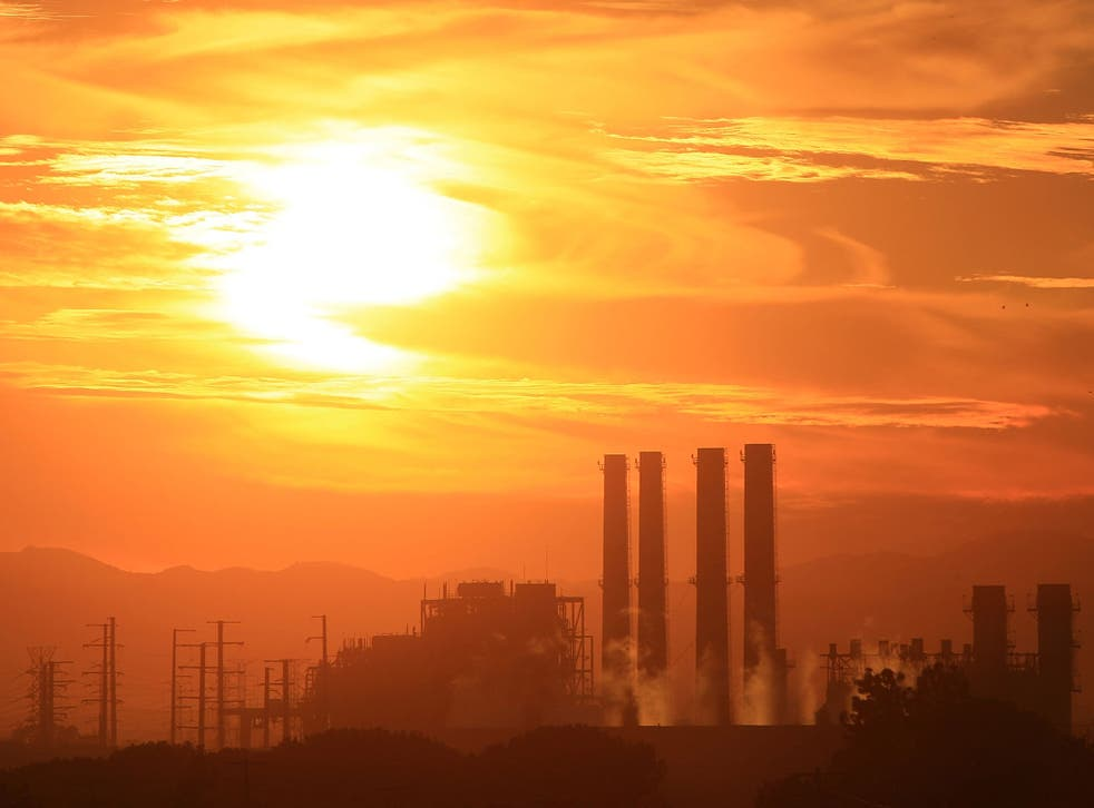 The Sun shines intensely above a power station in the Californian sky