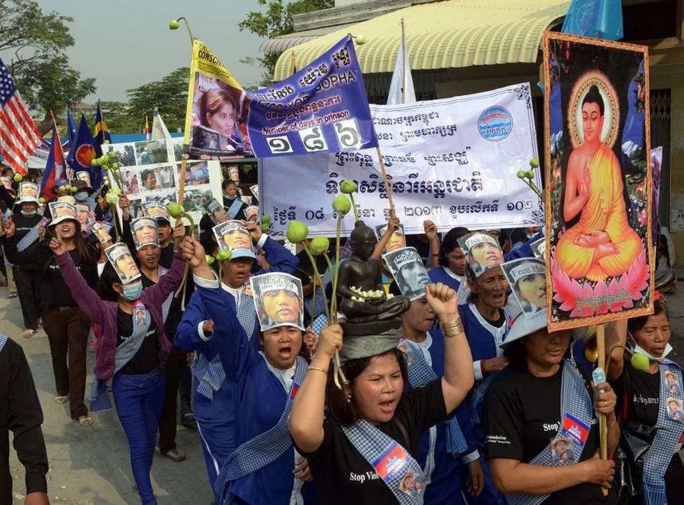 Cambodian women from Boeung Kak community shout slogans during a march on International Women's Day, Phnom Penh, March 8th 2013.