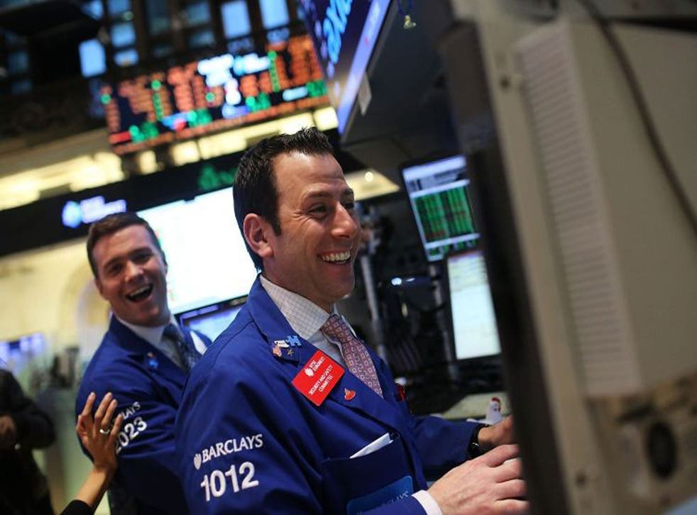 Traders celebrate the Dow's all-time high, but UK investors are advised not to get too excited
