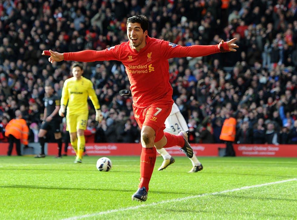 Luis Suarez of Liverpool celebrates his goal to make it 1-0