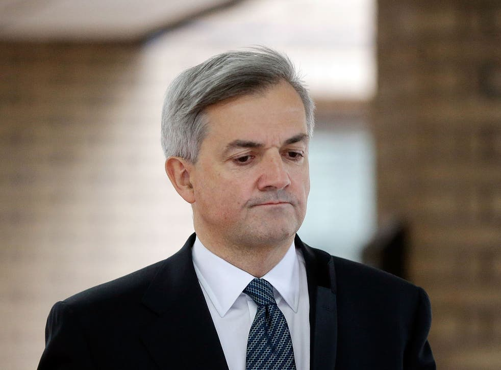 Former Cabinet Minister Chris Huhne leaves Southwark Crown Court to make a statement on February 4, 2013 in London, England.