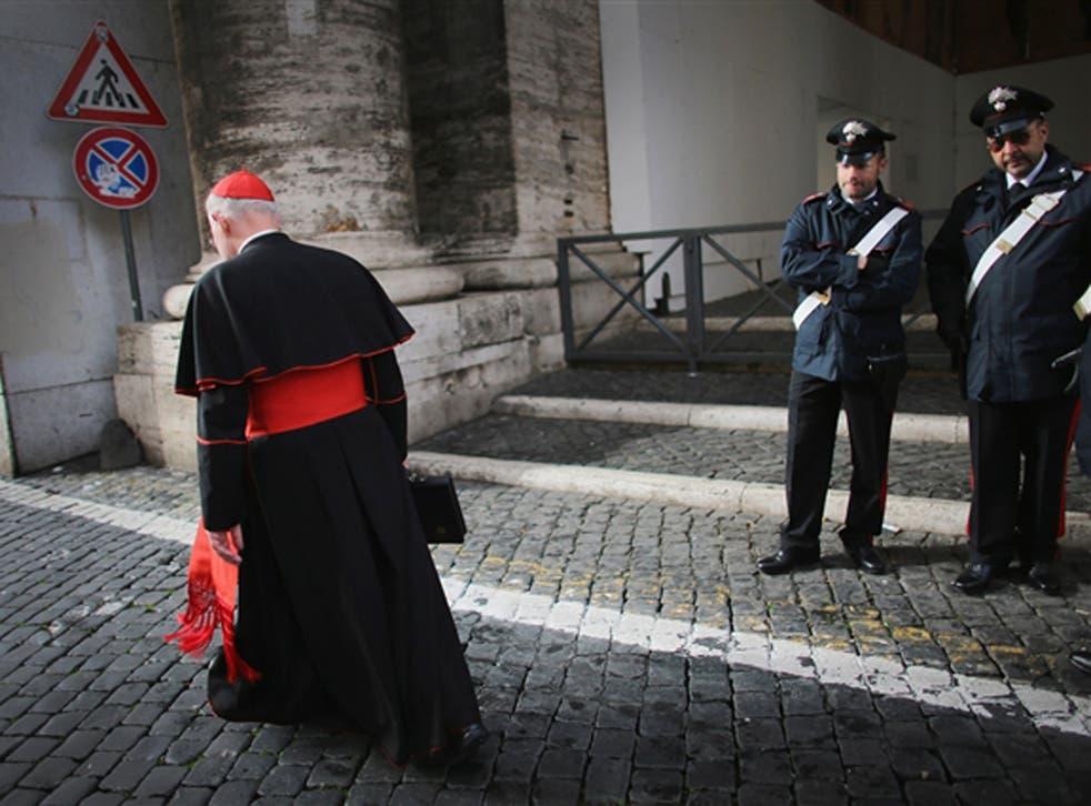A cardinal makes his way to Vatican City