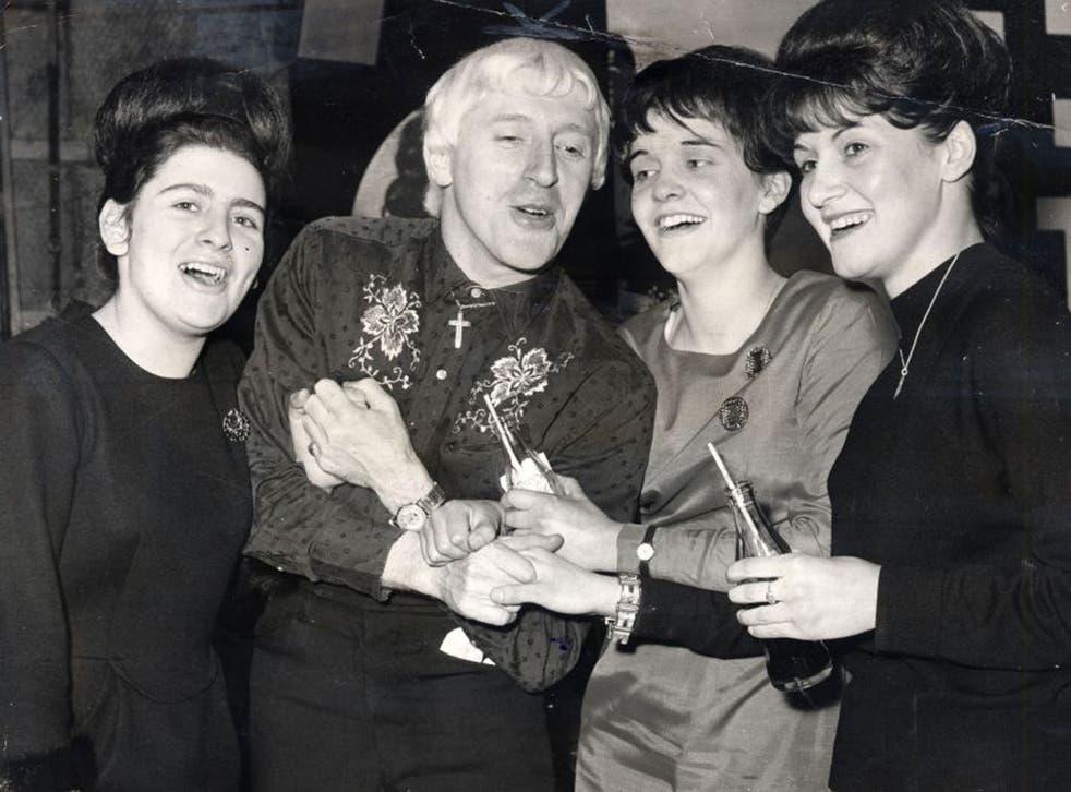 Jimmy Savile with Beatles fans in 1965Jimmy Savile with Beatles fans in 1965