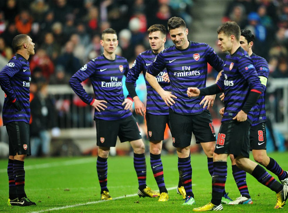 The Arsenal players appear dejected as they come to terms with their elimination from the tournament