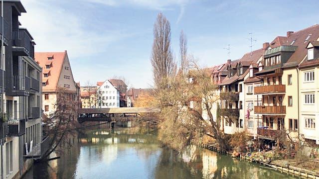Calm reflection: the Pegnitz river flows through the city
