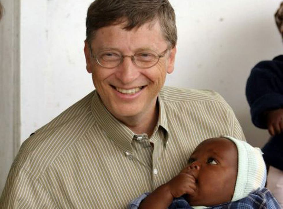 Bill Gates, co-founder of the Bill and Melinda Gates Foundation, with a young patient on a  malaria vaccine trial in Mozambique