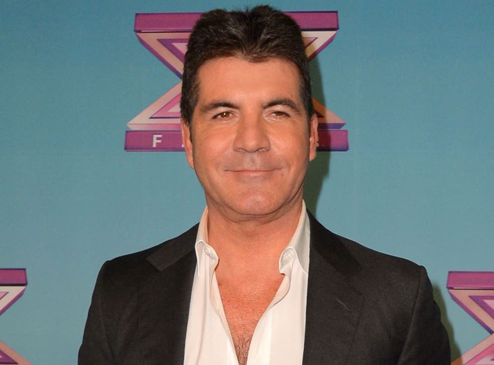 Simon Cowell is set to be a father, according to reports