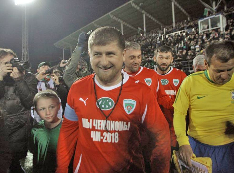 Ramzan Kadyrov, center, seen before a friendly game between Chechnya and Brazil in the stadium in Grozny