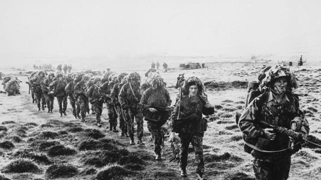 British soldiers cross the Falklands during the 1982 conflict
