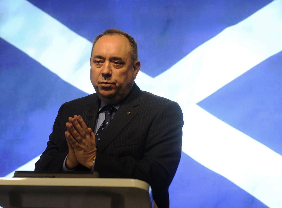 Scotland's First Minister Alex Salmond gestures during a press conference in St Andrews House in Edinburgh on October 15, 2012 after signing an agreement for a referendum on Scottish independence with the British prime minister.