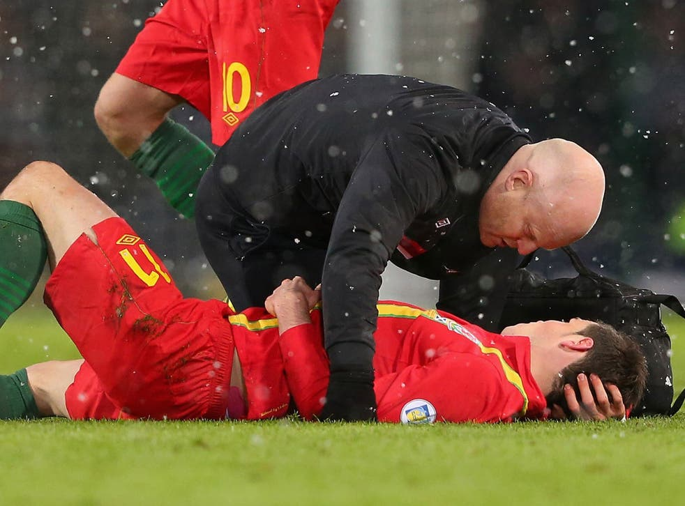 Down and out? Gareth Bale is in a race to recover from Friday's injury