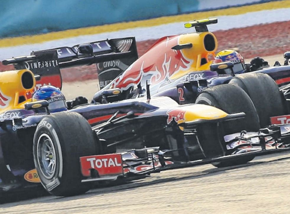 Seb Vettel passes Mark Webber yesterday despite team orders not to do so