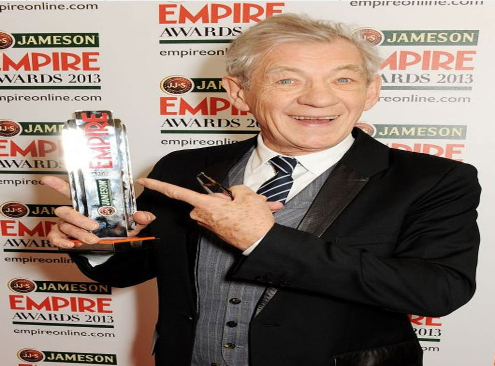 Sir Ian McKellen poses in the press room with the Best Science Fiction/Fantasy award for 'The Hobbit' at the Jameson Empire Awards 2013 at The Grosvenor House Hotel