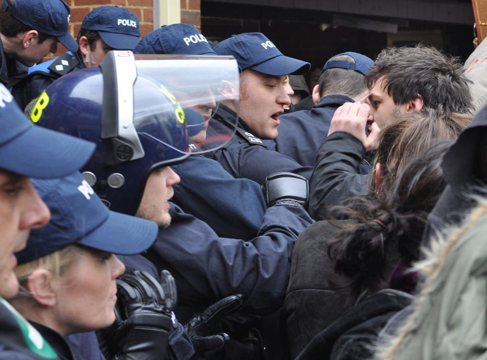 The outnumbered police were heckled into a corner by the hundreds of protesters