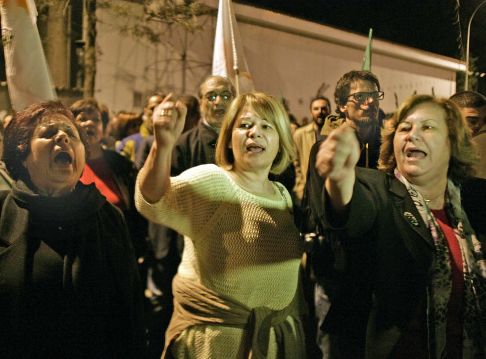 Protestors shout slogans against EU at protest outside a Eurogroup meeting at the European Council building last night