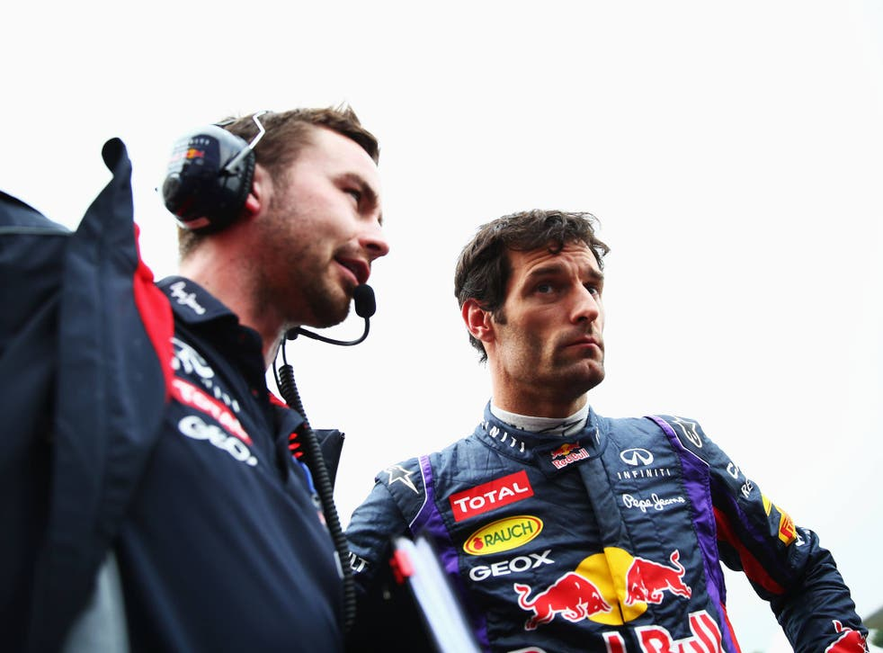Mark Webber of Australia and Infiniti Red Bull Racing talks with his race engineer Simon Rennie