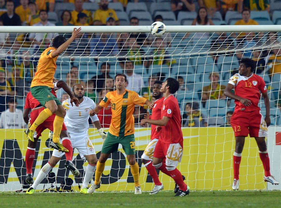 Tim Cahill pulls a goal back for Australia against Oman in a World Cup qualifier