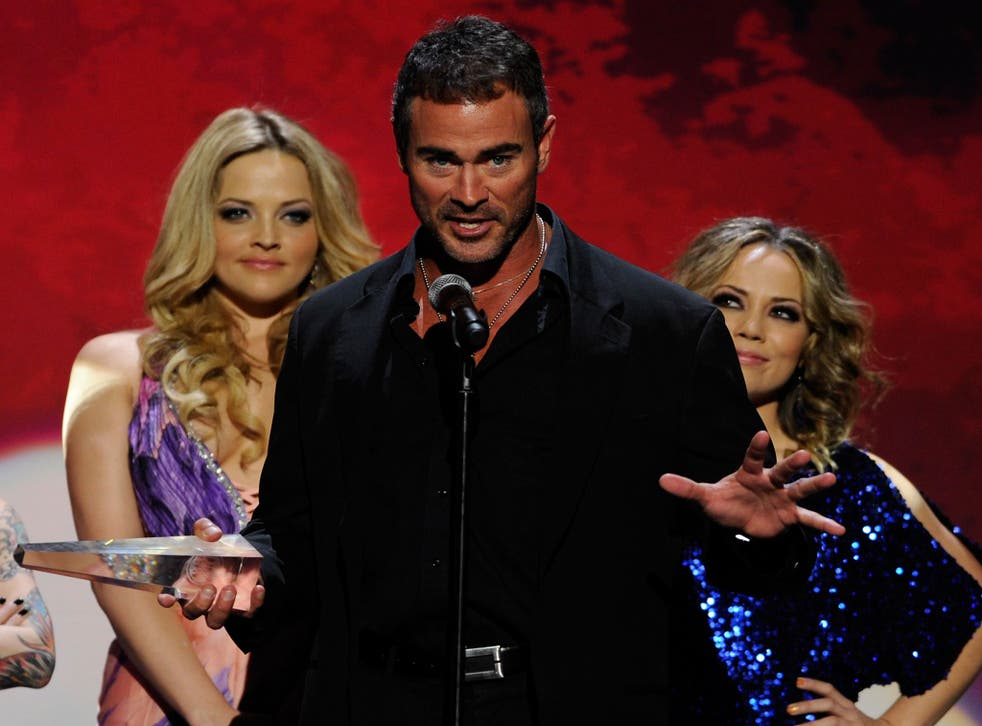 Adult film actor/director Dale Da Bone accepts a prize at the Adult Video News Awards