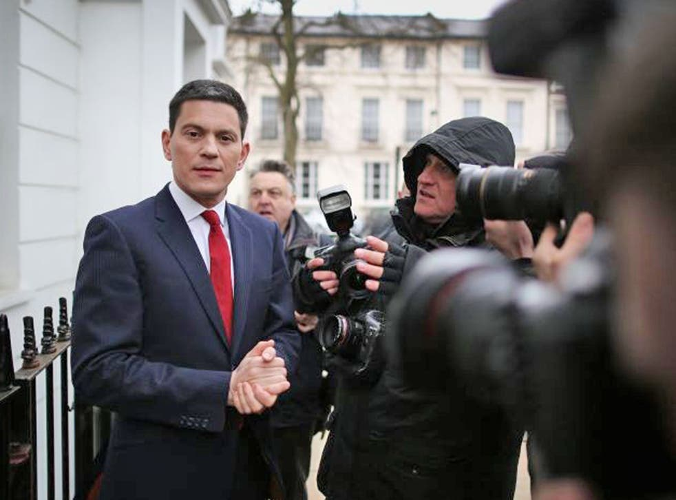 Former Foreign Secretary David Miliband talks to reporters at his home in London, England