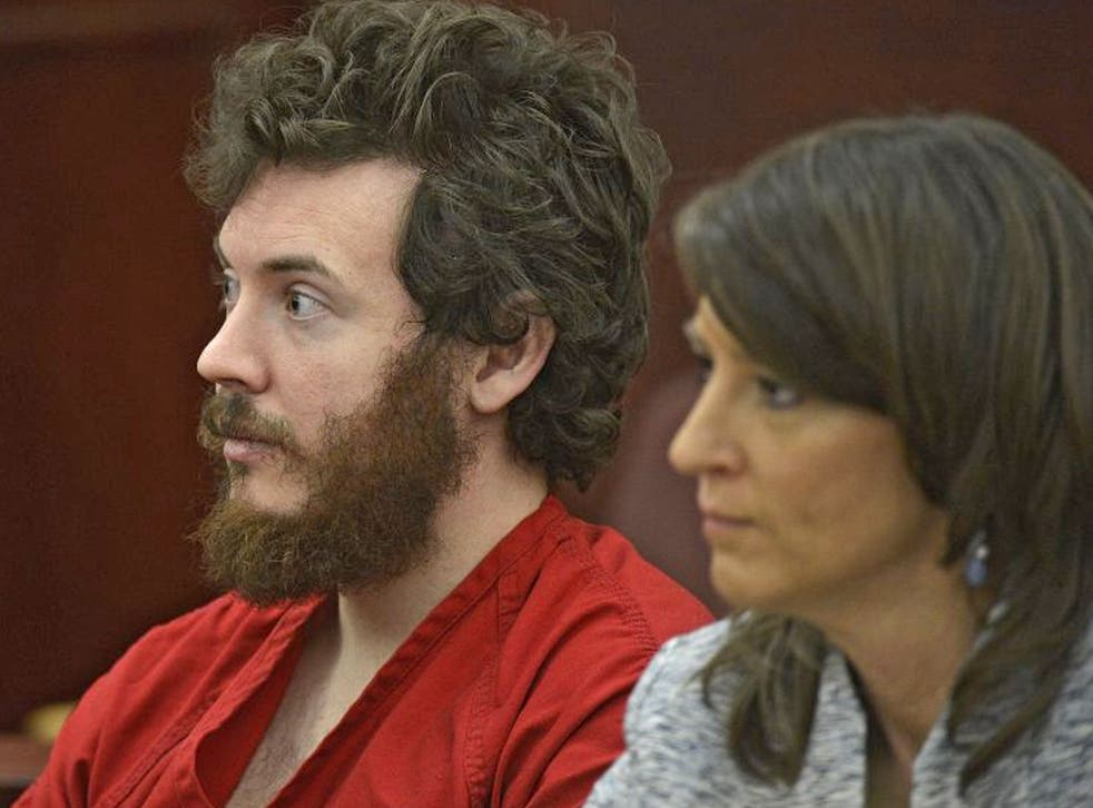 James Holmes, left, and defense attorney Tamara Brady appear in district court in Centennial, Colorado for his arraignment