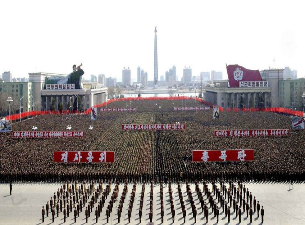 This photo released by North Korea shows a gathering at Kim Il Sung Square in Pyongyang