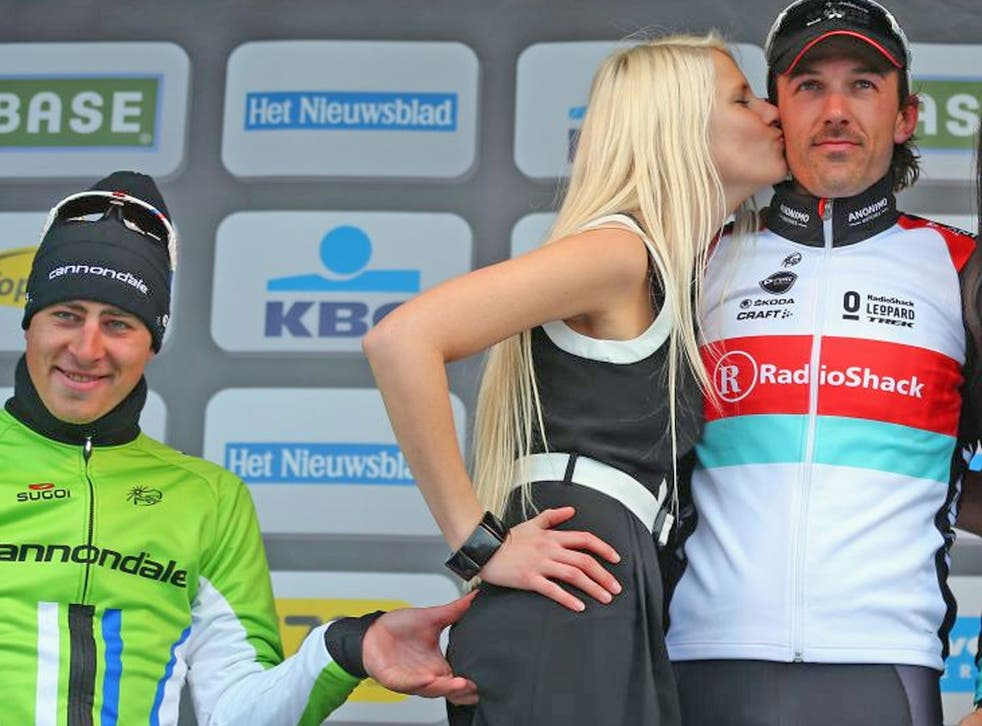 Slovakian cyclist Peter Sagan was caught pinching the bottom of a podium girl today