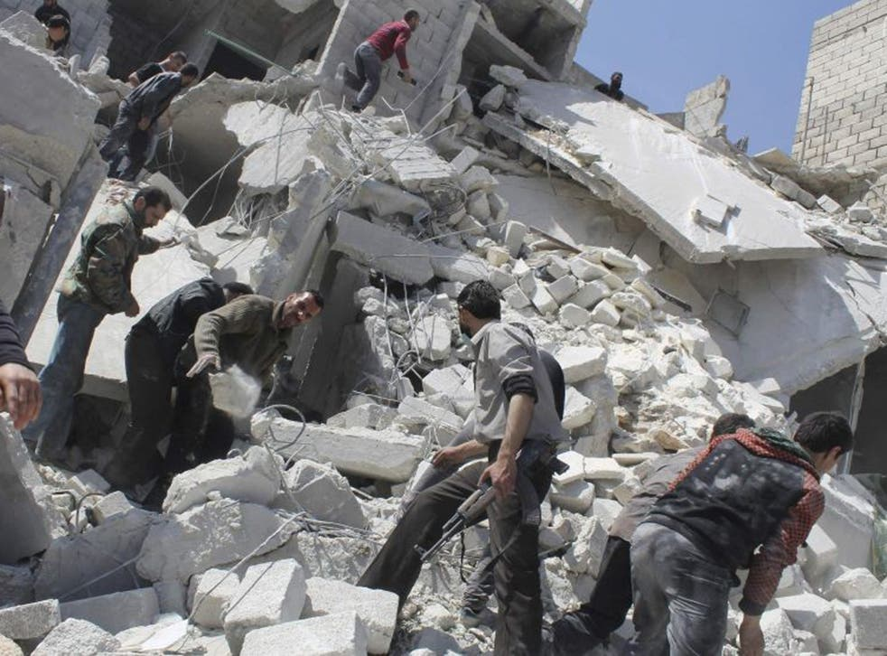 People search for casualties under the rubble at a site hit by what activists say was an air strike in Daiaat Al-Ansari neighborhood, Aleppo, on Saturday