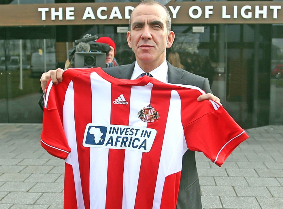 Paolo Di Canio poses with a club shirt after being unveiled as the new Sunderland manager
